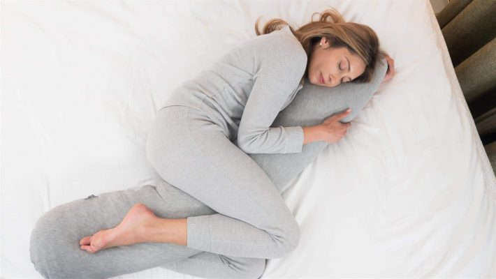 woman sleeping with Kally pillow