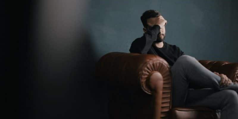 Depressed Man Sitting On Chair